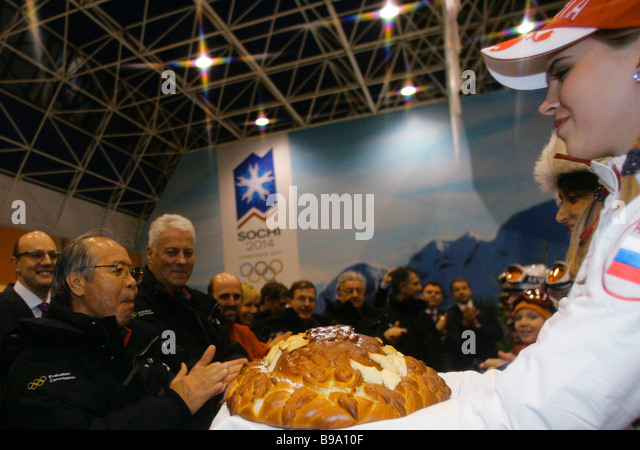 Greeting IOC evaluation commission members at the airport of Sochi on the Russian Black Sea coast which is bidding - Stock Image
