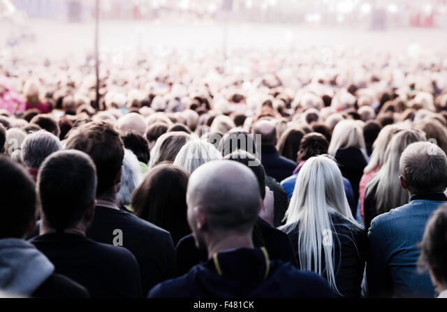 Crowd of unrecognisable people. Slow shutter speed motion blur for unrecognizability. - Stock Image