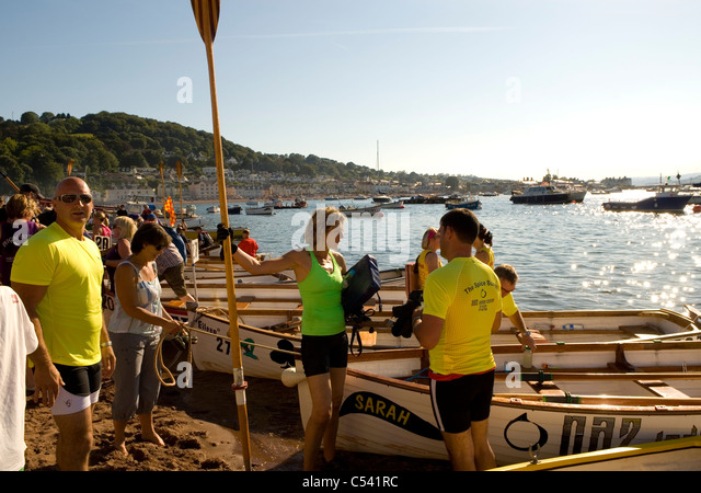 Gig rowers getting ready for local racing, Teignmouth, Devon, England, UK - Stock Image