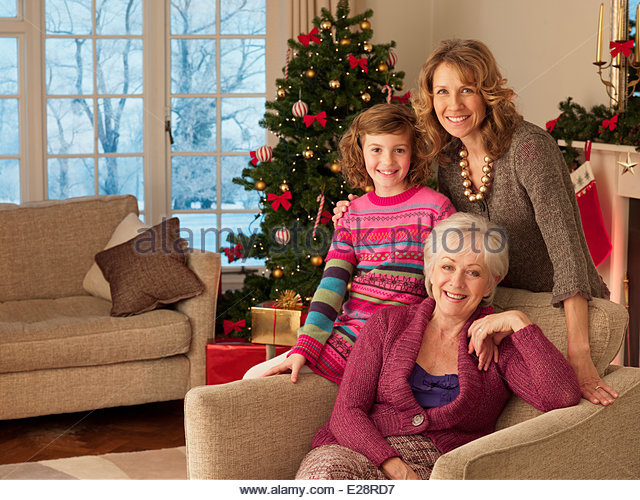 Multi-generation family near Christmas tree - Stock Image