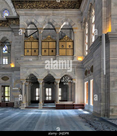 Interior of Nuruosmaniye Mosque, an Ottoman Baroque style mosque built in 1755, with arcades, wooden doors, windows, - Stock Image