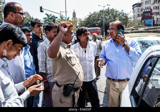 Mumbai India Asian Churchgate Veer Nariman Road policeman traffic patrol officer driver man minor accident - Stock Image