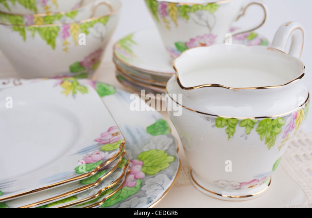 Old floral china tea service, marked Taylor and Kent, Longton, England. - Stock Image