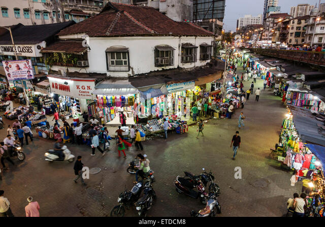 Mumbai India Indian Asian Grant Road East Bharat Nagar night nightlife shopping street market vendors pedestrians - Stock Image
