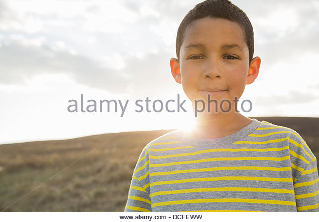 Portrait of schoolboy smiling - Stock-Bilder
