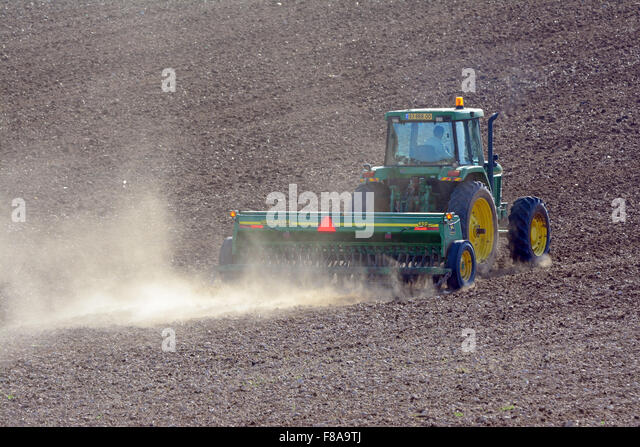 Tractor  plowing soil - Stock Image