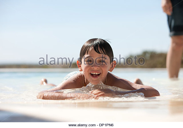 Boy in swimming pool - Stock Image
