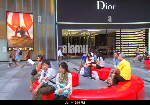 Singapore Orchard Road Ion Orchard mall complex upscale shopping Dior Louis Vuitton French fashion luxury designer - Stock Image