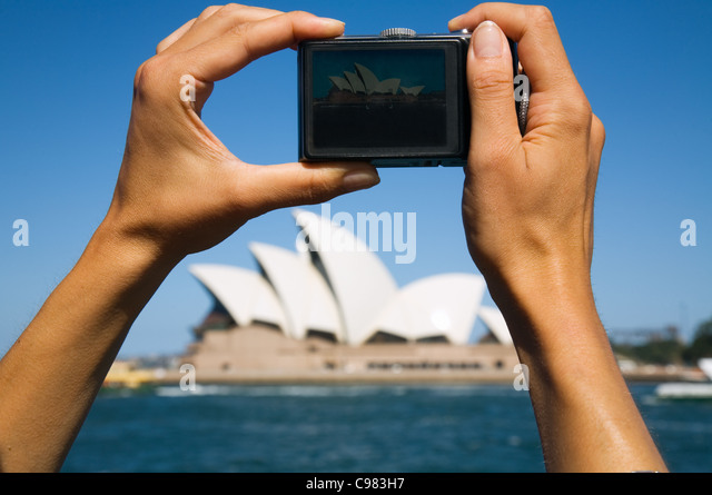 Taking a picture of the Sydney Opera House. Sydney, New South Wales, Australia - Stock-Bilder