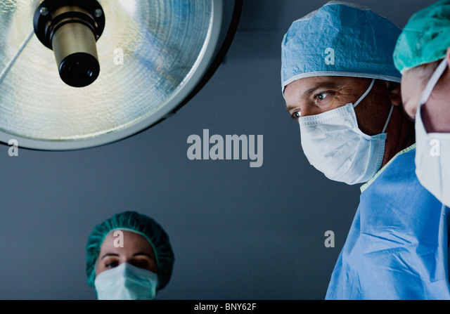 Surgical team at work operating room - Stock Image