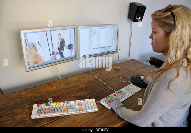 Young woman film editing, Camden Lock, Camden Town, London Borough of Camden, London, England, United Kingdom - Stock Image