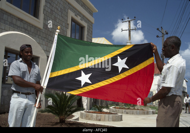 West Indies Nevis Charlestown St. Kitts and Nevis flag Black male city employees - Stock Image
