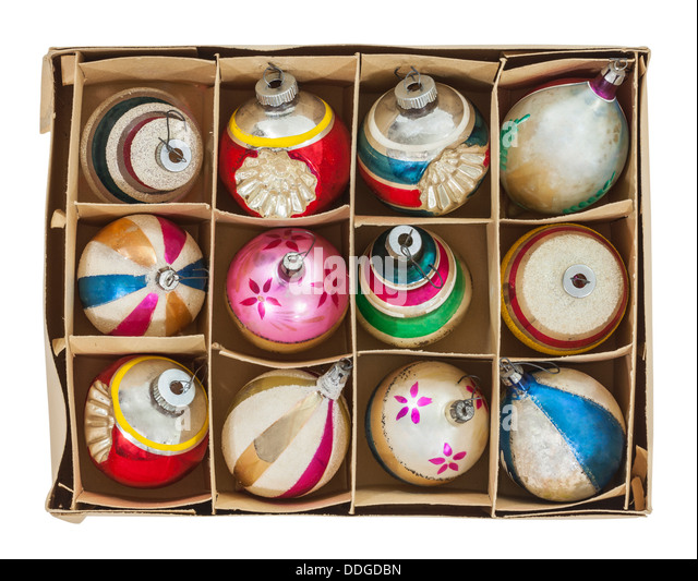Box of old Christmas tree ornaments isolated with clipping path. - Stock Image