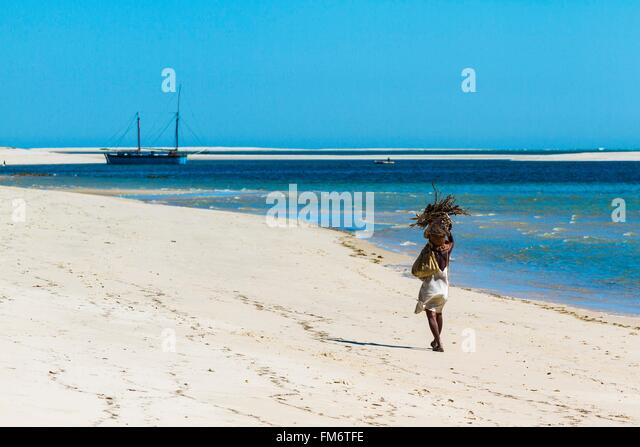 Madagascar, Menabe region, Belo sur Mer, the Mozambique Channel, woman walking on a beach - Stock Image
