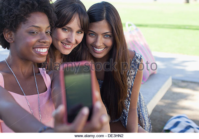 Women taking pictures of themselves - Stock Image