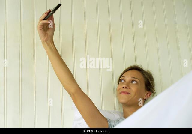 Woman taking selfie - Stock Image