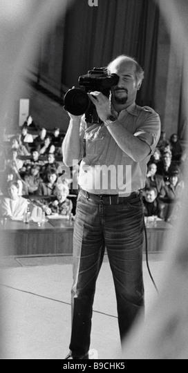 Cameraman films TV show - Stock Image