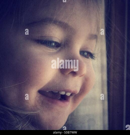 Smiling Toddler - Stock Image