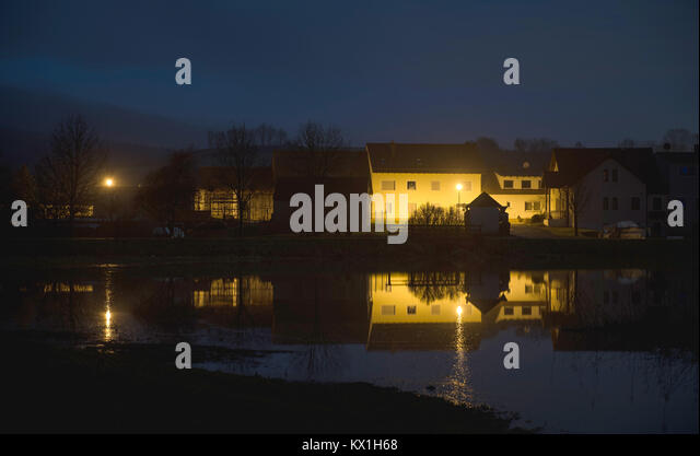 Busendorf, Germany. 6th Jan, 2018. The floodwater of the river Itz overflows the river banks flooding a nearby road - Stock Image