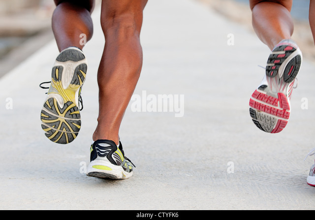 feet of fit healthy couple in jogging or running training session - Stock Image