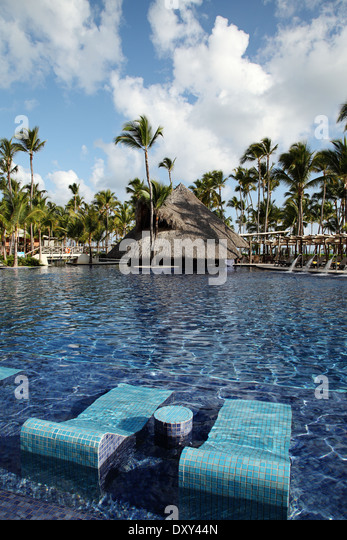 Tropical resort swimming pool in Punta Cana, Dominican Republic - Stock Image