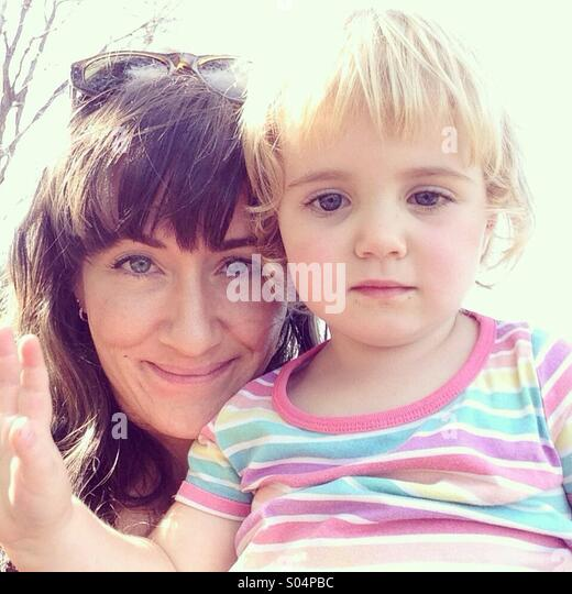 Mother and daughter in bright sunlight - Stock Image
