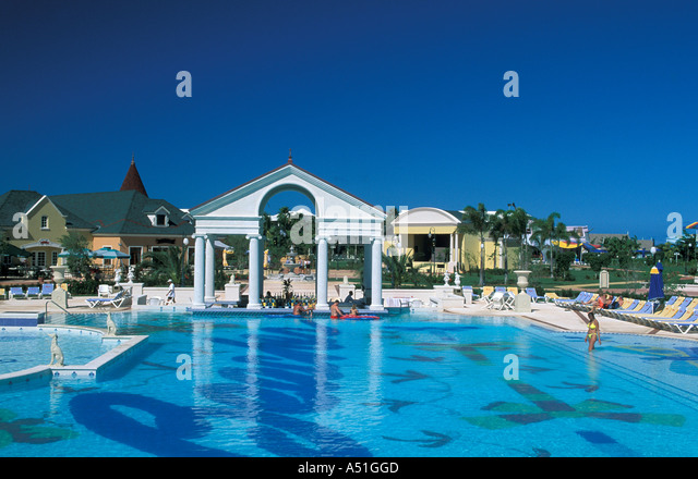 Large swimming pool with classic Greek columns arches Turks and Caicos Islands Beaches Resort Provo Providenciales - Stock Image