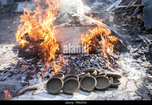 Burning pots - clay pots Production - Stock Image