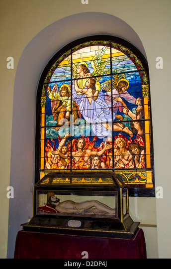 Interior Old San Cathedral or Cathedral of San Juan Bautista stained glass window, Puerto Rico - Stock Image