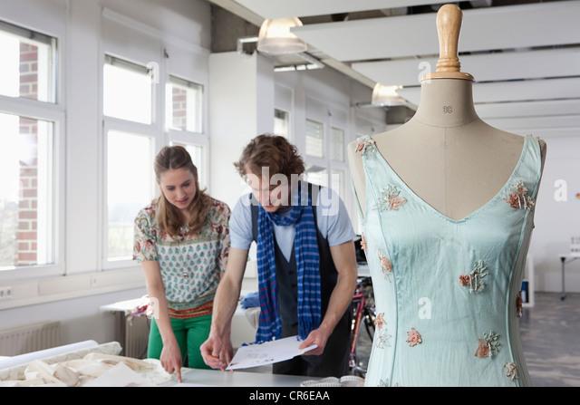 Germany, Bavaria, Munich, Fashion designers planning - Stock Image