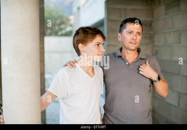 Father and son standing together - Stock Image