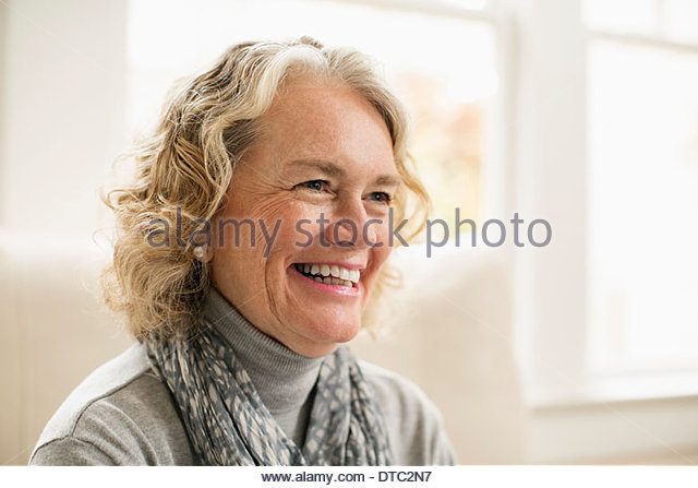 Portrait of happy senior woman at home - Stock Image