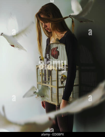 Woman with birdcage and doves - Stock-Bilder
