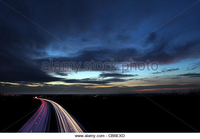 car headlight trails at night - Stock Image