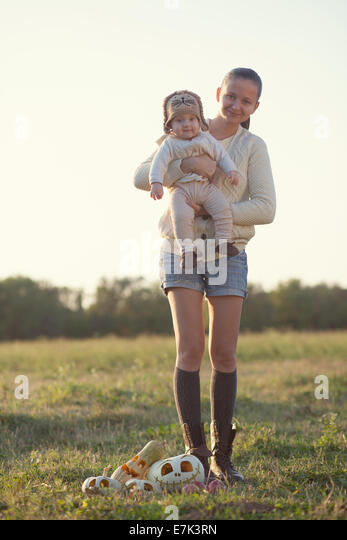 Portrait of fall styled mothet and baby - Stock Image