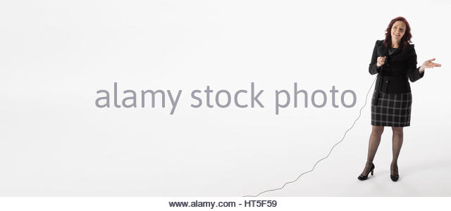 Businesswoman speaking with microphone against white background - Stock-Bilder