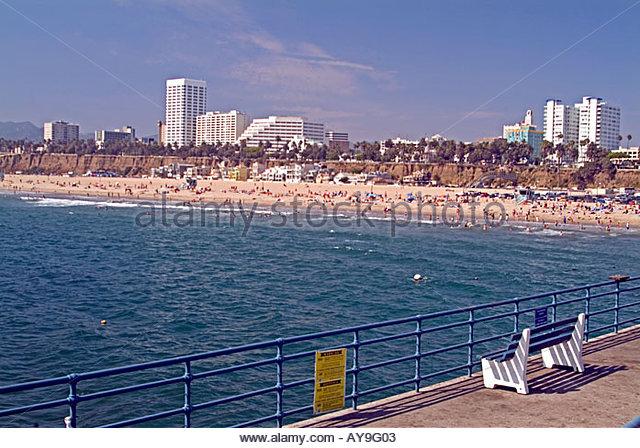 Santa Monica Pier California, CA, USA, US sandy beach, blue water, waves, people  beach hotels, bench, - Stock Image