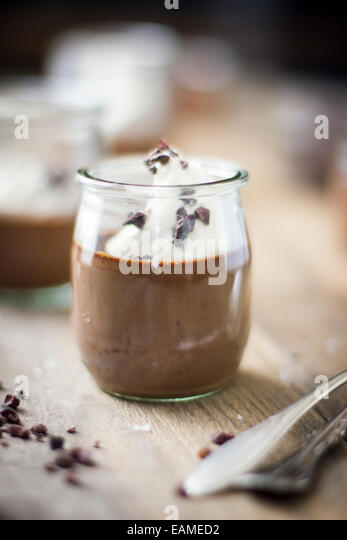 Chocolate Pot De Crème in Vintage Glass Jar - Stock Image