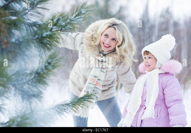 Happy parent and child playing with snow in winter outdoor - Stock-Bilder