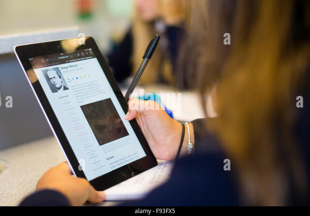 Secondary education Wales UK: student pupils using information technology (Apple iPad tablet computers) to research - Stock Image