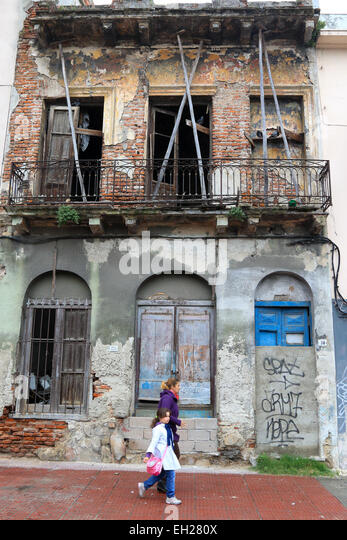 An old abandoned derelict building in Old Town Montevideo, Uruguay. - Stock Image