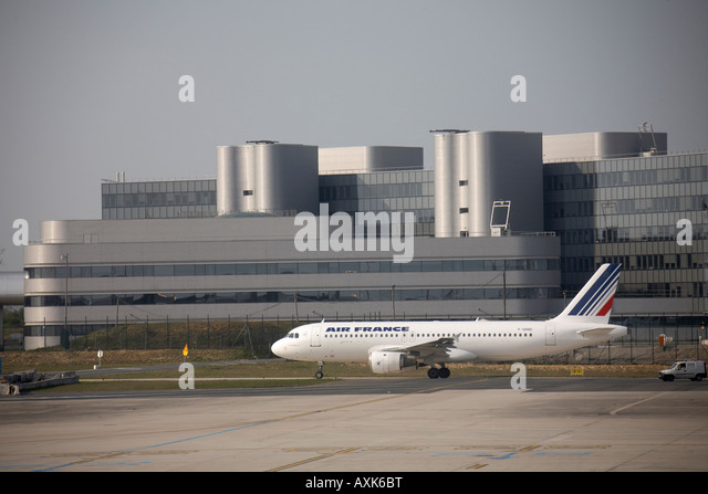 Air France Airbus A320 211 taxiing in front of modern buildings at Charles De Gaulle International Airport Paris - Stock Image
