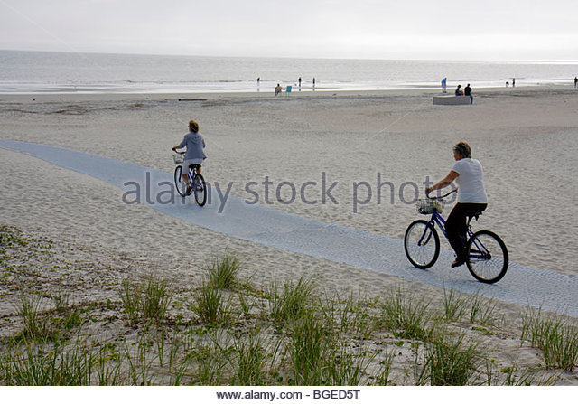 South Carolina Hilton Head Island South Forest Beach Atlantic Ocean resort dune grass woman bicycle cyclist cycle - Stock Image