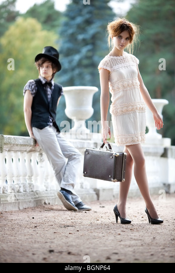Young couple fashion. Young walking lady and gentleman. - Stock Image