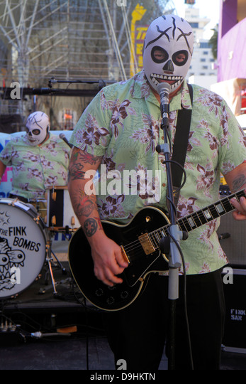 Nevada Las Vegas Downtown Fremont Street Experience The Fink Bombs rock and roll band skull masks free entertainment - Stock Image
