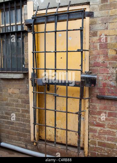 Heavily secured door - Stock Image