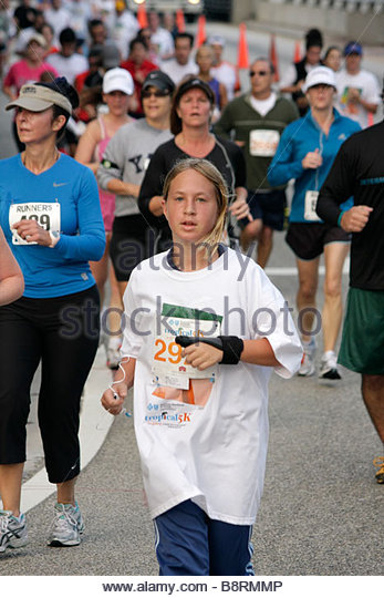 Miami Beach Florida Blue Cross and Blue Shield Tropical 5K Run race runner sports fitness girl teen road race competition - Stock Image