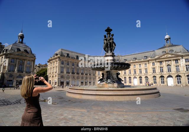 france, bordeaux, place de la bourse, tourist taking a picture - Stock Image