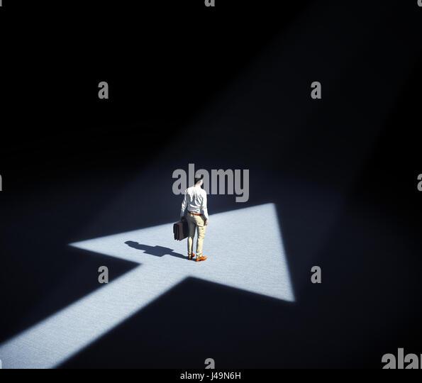 Man standing in a spotlight forming an arrow symbol - 3d illustration - Stock-Bilder