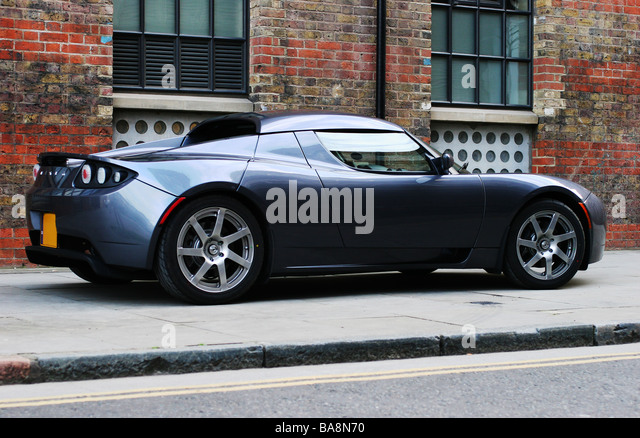 Tesla Roadster high-performance environmentally friendly electric sports car - Stock Image